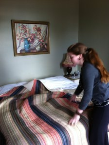 Head chamber maid Elizabeth Ickringill makes up the king size bed in The Old Police Station.